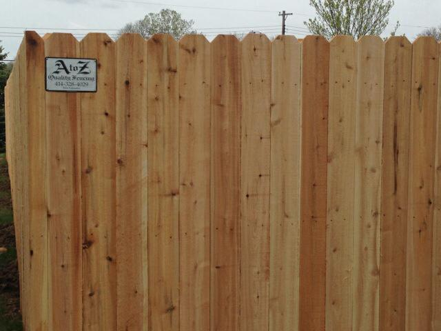 cedar fence west bend