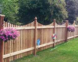 Wood picket fence with concave scallop top