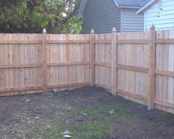 Wood privacy fence with dog-eared pickets