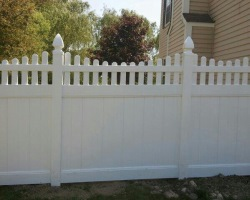 Zachary vinyl privacy fence with concave picket top edge
