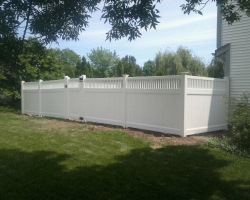 Vinyl Zachary-style privacy fence with lattice top edge